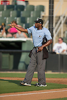 Home plate umpire Christopher Lloyd points to the mound during a pitching change during the game between the Delmarva Shorebirds and the Kannapolis Intimidators at CMC-Northeast Stadium on June 7, 2015 in Kannapolis, North Carolina.  The Shorebirds defeated the Intimidators 9-1.  (Brian Westerholt/Four Seam Images)