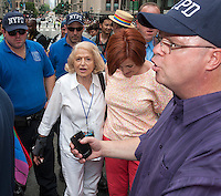 Edie Windsor, left and NYC Council Speaker and Mayoral candidate Christine Quinn, right, at the 44th annual Lesbian, Gay, Bisexual and Transgender Pride Parade on Fifth Avenue in New York on Sunday, June 30, 2013. Windsor, the Grand Marshal, was the lead plaintiff in the case that resulted in the over turning of DOMA and has endorsed Quinn for mayor. The turn out for the parade was especially large with the recent Supreme Court decision overturning the Defense of Marriage Act (DOMA) and California's Proposition 8.   (© Richard B. Levine)