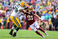 Landover, MD - September 23, 2018: Washington Redskins linebacker Ryan Kerrigan (91) and Green Bay Packers offensive tackle Jason Spriggs (78) battle in the trenches during game between the Green Bay Packers and the Washington Redskins at FedEx Field in Landover, MD. The Redskins get the win 31-17 over the visiting Packers. (Photo by Phillip Peters/Media Images International)