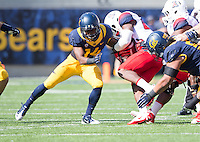 Saturday, November 2nd, 2013: California's Cameron Walker tackles Arizona's Ka'Deem Carey during a game at Memorial Stadium, Berkeley, Final Score: Arizona defeated California 33-28