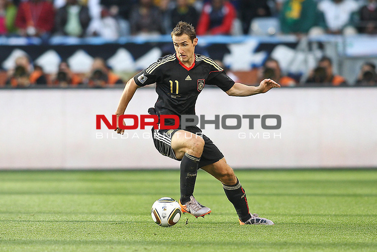 03.07.2010, CAPE TOWN, SOUTH AFRICA, im Bild <br /> Miroslav Klose of Germany on the attack during the Quarter Final, Match 59 of the 2010 FIFA World Cup, Argentina vs Germany held at the Cape Town Stadium.<br /> Foto &copy;  nph /  Kokenge *** Local Caption *** Fotos sind ohne vorherigen schriftliche Zustimmung ausschliesslich f&uuml;r redaktionelle Publikationszwecke zu verwenden.<br /> <br /> Auf Anfrage in hoeherer Qualitaet/Aufloesung