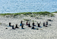 Morning beach yoga class, Chatham, Cape Cod, Massachusetts, USA.