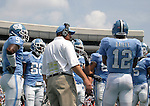 09 September 2006: UNC offensive coordinator Frank Cignetti (in white) during a timeout with offensive starters Jesse Holley (9), Hakeem Nicks (88), Joe Dailey (12), and others. The University of North Carolina Tarheels lost 35-10 to the Virginia Tech Hokies at Kenan Stadium in Chapel Hill, North Carolina in an Atlantic Coast Conference NCAA Division I College Football game.