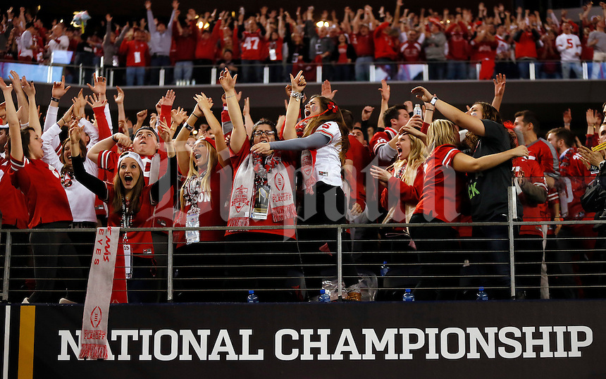 Ohio State fans cheer as running back Ezekiel Elliott (15) scores a touchdown during the 3rd quarter against Oregon in the College Football Playoff National Championship at AT&T Stadium in Arlington, Texas on Jan. 12, 2015. (Adam Cairns / The Columbus Dispatch)