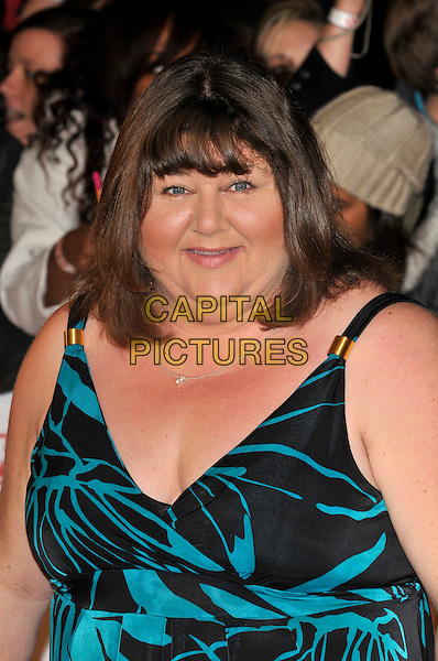 CHERYL FERGISON .Attending the National Television Awards at O2 Arena, London, England..January 26th, 2011.NTA NTAs arrivals portrait headshot black  blue turquoise .CAP/PL.©Phil Loftus/Capital Pictures.