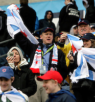 A Chicago Red Star fan cheers for the team.  The Chicago Red Stars tied Sky Blue FC 0-0 at Toyota Park in Bridgeview, IL on April 19, 2009.