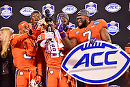 Charlotte, NC - DEC 2, 2017: Clemson Tigers cornerback Marcus Edmond (29) cornerback Ryan Carter (31)  defensive end Austin Bryant (7) and Clemson Tigers defensive end Clelin Ferrell (99) celebrate on stage after winning the ACC Championship game over Miami 38-3 at Bank of America Stadium Charlotte, North Carolina. (Photo by Phil Peters/Media Images International)