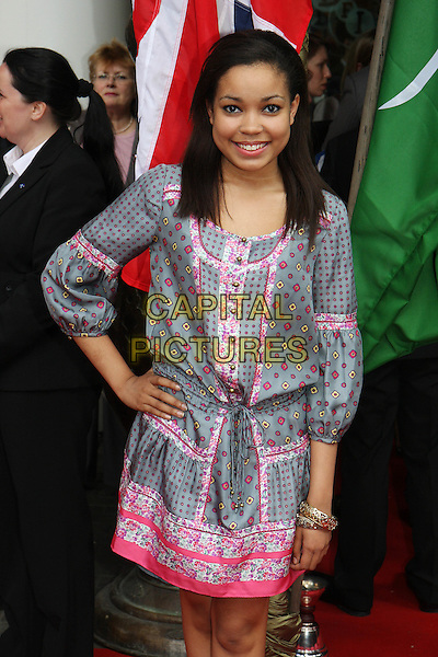 DIONNE BROMFIELD .Royal Film Premiere of 'Arabia 3D' at the BFI Imax cinema, Waterloo, London, England, UK, May 24th 2010 . .arrivals half length pink folk print peasant dress grey gray hand on hip summery tunic bracelet.CAP/MAR.© Martin Harris/Capital Pictures.