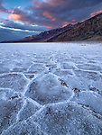 Stormy sunset over the Badwater Salt Flats and Funeral Mountains in the Amargosa Range in Death Valley National Park, CA