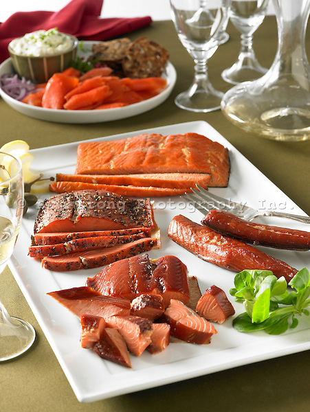 A large assortment of smoked salmon and lox on large platter