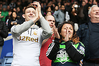 Swansea fans applaud the team after the Barclays Premier League match between Leicester City and Swansea City played at The King Power Stadium, Leicester on April 24th 2016