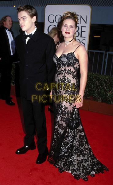 KATE WINSLET & LEONARDO DICAPRIO..Golden Globe Awards..Ref: 7035..lace dress, tuxedo, full length, full-length, red carpet..www.capitalpictures.com..sales@capitalpictures.com..©Capital Pictures