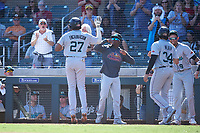 Salt River Rafters Jerar Encarnacion (27), of the Miami Marlins organization, is congratulated by Vidal Brujan (33), Royce Lewis (9), and Colton Welker (34) after hitting a grand slam during the Arizona Fall League Championship Game against the Surprise Saguaros on October 26, 2019 at Salt River Fields at Talking Stick in Scottsdale, Arizona. The Rafters defeated the Saguaros 5-1. (Zachary Lucy/Four Seam Images)