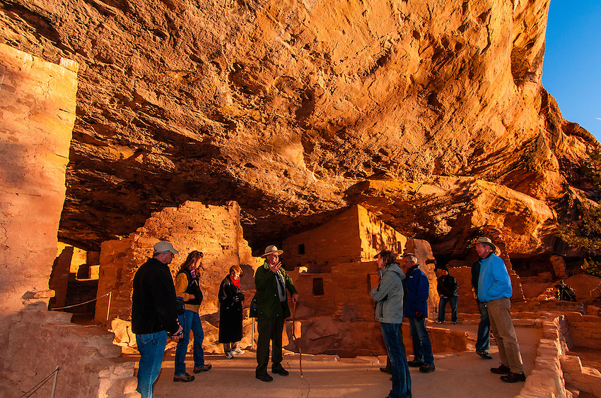 A park ranger giving a tour of Spruce Tree House, Mesa Verde National Park, Colorado USA