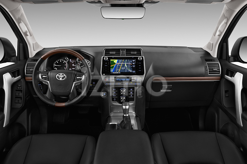 Stock photo of straight dashboard view of 2018 Toyota Land-Cruiser-150 Premium 5 Door SUV Dashboard