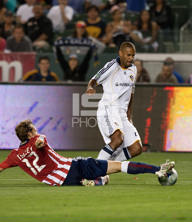 Tony Sanneh (right) tries to escape Carey Talley (12). The LA Galaxy defeated Chivas USA 1-0 at Home Depot Center stadium in Carson, California Saturday evening July 11, 2009.