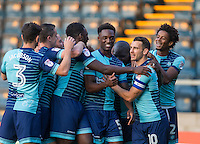 Celebrations as Adebayo Akinfenwa of Wycombe Wanderers scores his goal during the Sky Bet League 2 match between Wycombe Wanderers and Accrington Stanley at Adams Park, High Wycombe, England on 16 August 2016. Photo by Andy Rowland.