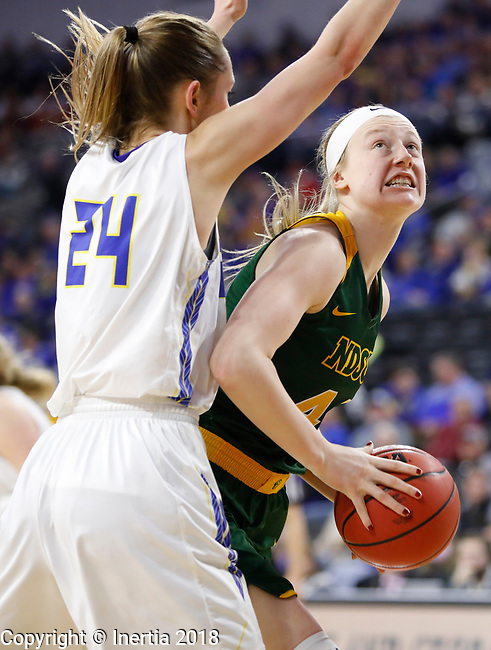 SIOUX FALLS, SD - MARCH 3:  NDSU's Danneka Voegeli #44 looks to the rim over the arms of SDSU's Tagyn Larson #24 at the 2018 Summit League Basketball tournament at the Denny Sanford Premier Center in Sioux Falls. (Photo by Dick Carlson/Inertia)