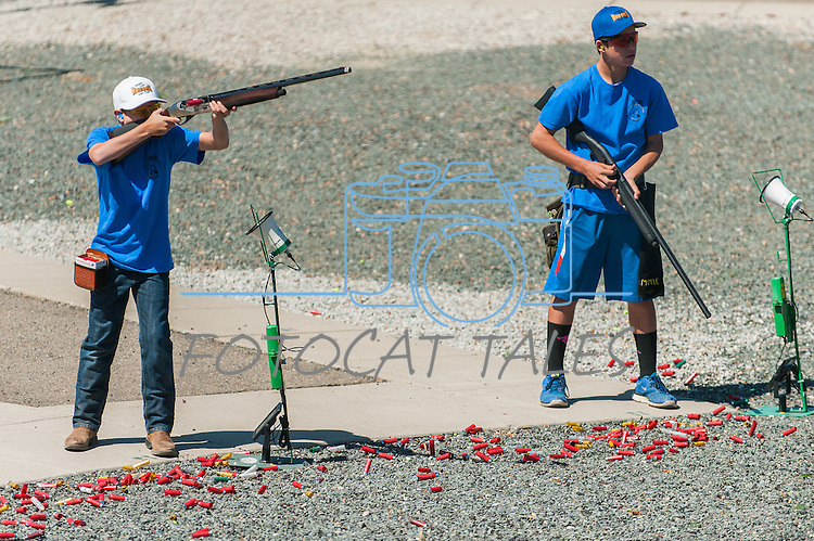 Mother Lode Gun Club's Jack Morey,left, and Tanner Morey compete during the California Youth Shotgun Shooting Association's championship shootout at the Capitol City Gun Club in Carson City, Nev. on Saturday, May 2, 2015.<br /> Photo by Kevin Clifford/Nevada Photo Source