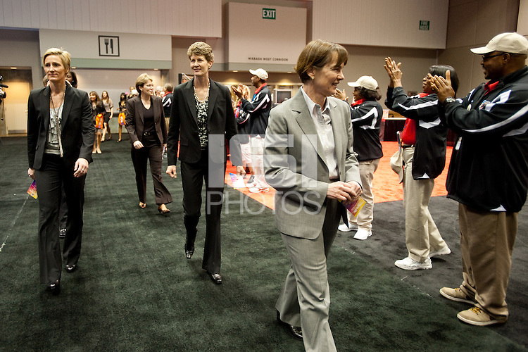 INDIANAPOLIS, IN - APRIL 1, 2011: Head Coach Tara VanDerveer, Amy Tucker, and Kate Paye enjoy the festivities at the Cirque du Salute at the Indianapolis Convention Center at Tourney Town during the NCAA Final Four in Indianapolis, IN on April 1, 2011.