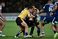 Francis Saili ( Blues ) and Chris Smylie ( Hurricanes ) in action during the Super Rugby - Hurricanes v Blues at FMG Stadium, Palmerston North, New Zealand on Friday 13 March 2015. <br /> Photo by Masanori Udagawa. <br /> www.photowellington.photoshelter.com.