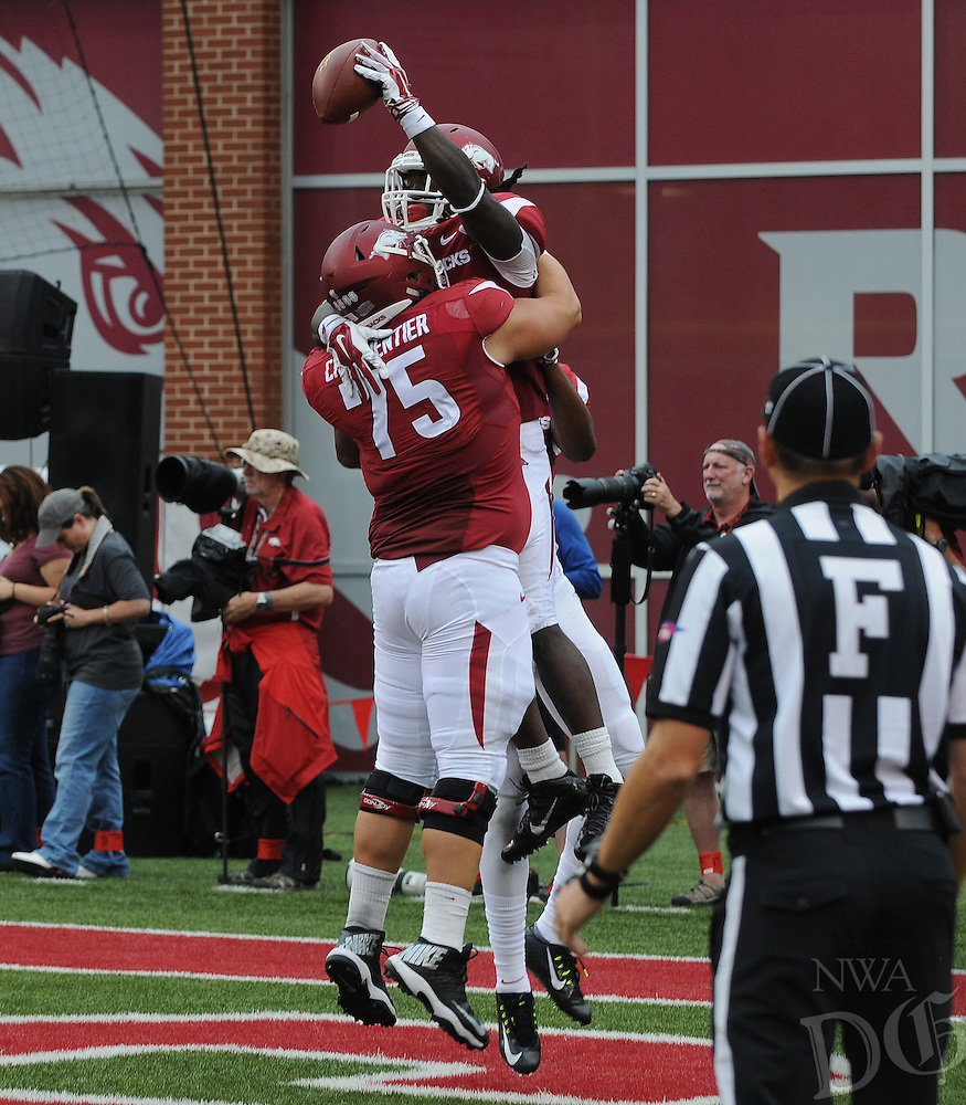 STAFF PHOTO ANTHONY REYES • @NWATONYR<br /> Luke Charpentier, Razorbacks center celebrates a touchdown with Alex Collins against Nicholls State in the second quarter Saturday, Sept. 6, 2014 at Razorback Stadium in Fayetteville.