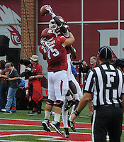 STAFF PHOTO ANTHONY REYES &bull; @NWATONYR<br /> Luke Charpentier, Razorbacks center celebrates a touchdown with Alex Collins against Nicholls State in the second quarter Saturday, Sept. 6, 2014 at Razorback Stadium in Fayetteville.