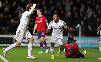 Sunday, 28 November 2012<br /> Pictured: Michu (L) and Wayne Routledge (R).<br /> Re: Barclays Premier League, Swansea City FC v West Bromwich Albion at the Liberty Stadium, south Wales.