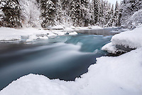 Winter landscape of slow exposure of partially frozen Granite Creek and snow covered trees in the Turnagain Pass area of Kenai Penninsula Alaska  December 2015<br /> <br /> Photo (C) Jeff Schultz/SchultzPhoto.com