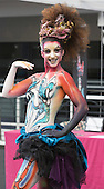 London, UK. 11 April 2015. Model Caroline Can displays a full bodypainting design by makeup artist Mylène Ruaux. United Makeup Artists Expo (UMAe),  the UK's leading aspiring and professional hair and makeup artist trade show, gets underway at the Business Design Centre in Islington, London, UK. It runs until Sunday, 12 April. At this trade show leading professionals provide demonstrations and the latest techniques and products are showcased.