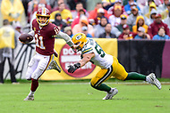 Landover, MD - September 23, 2018: Washington Redskins quarterback Alex Smith (11) avoids tackle by Green Bay Packers linebacker Clay Matthews (52) during game between the Green Bay Packers and the Washington Redskins at FedEx Field in Landover, MD. The Redskins get the win 31-17 over the visiting Packers. (Photo by Phillip Peters/Media Images International)