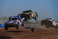 Apr 16, 2011; Surprise, AZ USA; LOORRS driver Ricky Johnson (48) leads Kyle Leduc (99) and Carl Renezeder (17) during round 3 at Speedworld Off Road Park. Mandatory Credit: Mark J. Rebilas-.