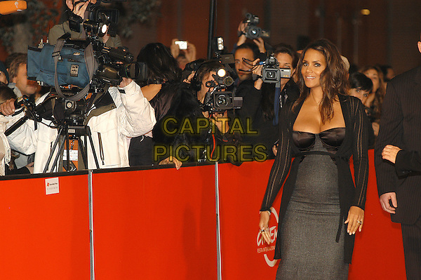 "HALLE BERRY .Red carpet arrivals for the film ""Things We Lost In The Fire"" during the 2nd Annual Rome Film Festival, Rome, Italy, 26th October 2007. .half length black dress pregnant grey plaid tartan print.CAP/CAV.©Luca Cavallari/Capital Pictures."
