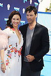 WESTWOOD, CA- SEPTEMBER 07: Actors Ashley Judd (R) and Harry Connick, Jr. arrive at the Los Angeles premiere of 'Dolphin Tale 2' at Regency Village Theatre on September 7, 2014 in Westwood, California.