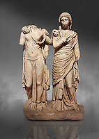 Roman statue of two women; Marble. Perge. 2nd century AD. Inv 3271. Antalya Archaeology Museum; Turkey. Against a grey background