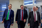 United States Senator Ron Wyden (Democrat of Oregon) left, US Senator Joe Donnelly (Democrat of Indiana), center, and US Senator Ben Cardin (Democrat of Maryland), walk through the Senate Subway on their way to a Democratic Caucus meeting on a night when Congress tries to pass a spending bill to avoid a government shutdown in Washington, D.C. on January 19th, 2018. Credit: Alex Edelman / CNP