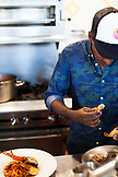 BERMUDA. Hamilton. Hamilton Princess & Beach Club Hotel. Marcus' Restaurant. Chef Marcus Samuelsson trying a pasta dish in the kitchen.