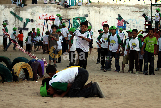 Palestinian boys play at a summer camp organised by the Islamist movement Hamas in Gaza City on June 23, 2011. Photo by Ali Jadallah