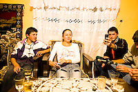 ROMANIA / Maramures / Sarbi / 14.10.2006 ..Anuta, 16, with her suitors from the neighboring village of Budesti. It is customary for as many as a dozen young men to show up to court just one girl and it is obligatory to bring along some plum brandy, beer or wine as a gift. Invariably though, the boys end up drinking it all themselves. After the fall of Communism, change was slow to enter the remote region of Maramures and up to a decade ago Western fashions had not been fully adopted amongst the youth. But with an increasing number of young peasants working abroad each year, money and Western influences have flooded the villages and their now exists a curious blend of centuries-old European traditionalism and pop culture. ..© Davin Ellicson / Anzenberger