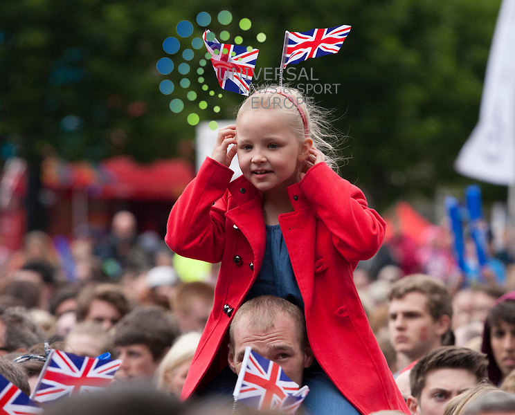 In Picture: A young girl in the crowd sports a head band with British flags. Brit Award winning Emeli Sande perform at the London 2012 Olympic torch Relay Special City Celebration in Glasgow's George Square, presented by Coca-Cola...Picture: Jonathan Faulds / Universal News And Sport (Europe)