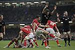 Cardiff, WALES - November 24:.Autumn International.Wales v New Zealand.Mike Phillips clears the ball from the Wales goal line under pressure from Sam Whitelock..24.11.12..©Steve Pope - Sportingwales