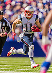 12 October 2014: New England Patriots wide receiver Julian Edelman runs for yardage against the Buffalo Bills at Ralph Wilson Stadium in Orchard Park, NY. The Patriots defeated the Bills 37-22 to move into first place in the AFC Eastern Division. Mandatory Credit: Ed Wolfstein Photo *** RAW (NEF) Image File Available ***