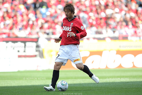 Mitsuru Nagata, (Reds), APRIL 24th, 2011 - Football : J.LEAGUE Division 1, 7th Sec match between Urawa Reds 3-0 Nagoya Grampus at Saitama Stadium 2002, Saitama, Japan. The J.League resumed on Saturday 23rd April after a six week enforced break following the March 11th Tohoku Earthquake and Tsunami. All games kicked off in the daytime in order to save electricity and title favourites Kashima Antlers are still unable to use their home stadium which was damaged by the quake. Velgata Sendai, from Miyagi, which was hard hit by the tsunami came from behind for an emotional 2-1 victory away to Kawasaki. (Photo by Akihiro Sugimoto/AFLO SPORT) [1080]