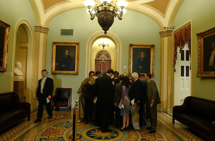 Sen. Arlen Specter, R-Pa., is surrounded by reporters after the Senate Luncheons.