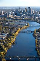 Mississippi river leads the eye towards the skyline of Minneapolis, Minnesota, USA.