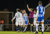 Referee Trevor Kettle sends off Joe Jacobson of Wycombe Wanderers with a red card during the Sky Bet League 2 match between Colchester United and Wycombe Wanderers at the Weston Homes Community Stadium, Colchester, England on 21 February 2017. Photo by Andy Rowland / PRiME Media Images.