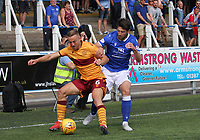 Lewis Kidd tackling Allan Campbell in the SPFL Betfred League Cup group match between Queen of the South and Motherwell at Palmerston Park, Dumfries on 13.7.19.