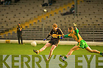 Dr Crokes Colm Cooper drives this ball over despite the best efforts of Gneeveguilla's Fergus McAulliffe during their O'Donoghue Cup final clash in the Fitzgerald Stadium, Killarney on Sunday.
