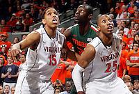 Virginia forward Akil Mitchell (25) and Virginia guard Malcolm Brogdon (15) during an NCAA basketball game Saturday Feb, 24, 2014 in Charlottesville, VA. Virginia defeated Miami 65-40.