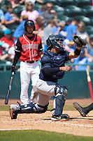 Charleston RiverDogs catcher Eduardo Navas (20) fields a throw at home plate during the game against the Hickory Crawdads at L.P. Frans Stadium on May 13, 2019 in Hickory, North Carolina. The Crawdads defeated the RiverDogs 7-5. (Brian Westerholt/Four Seam Images)